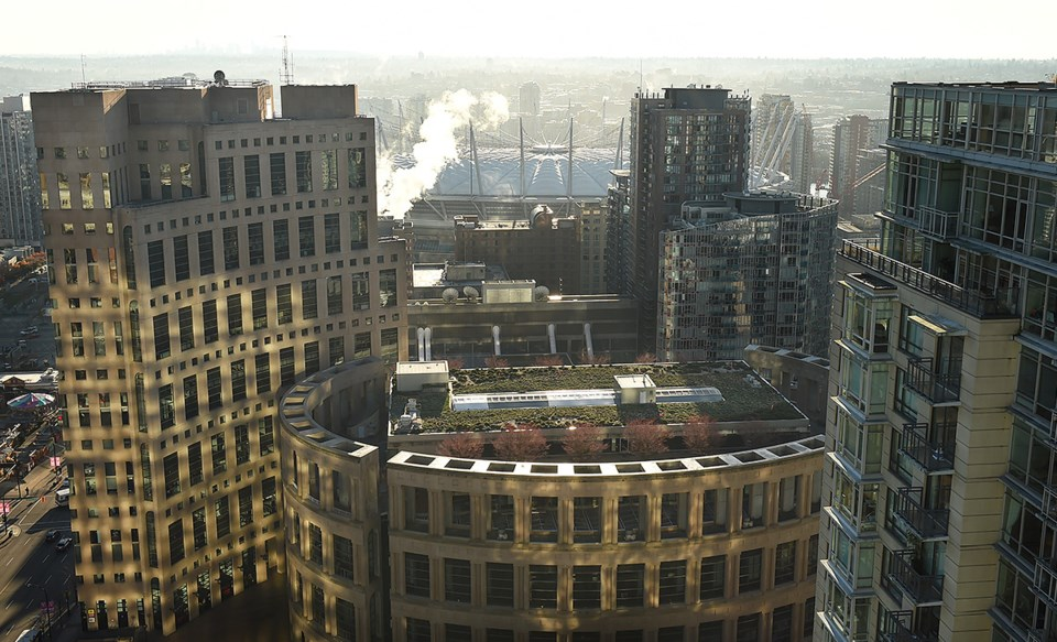 The main branch of the Vancouver Public Library lit with morning light. Photo Dan Toulgoet