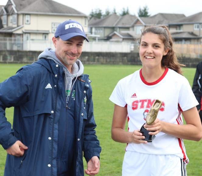 St. Thomas More's Kaya Crescenzo receives the tourney's MVP award after helping lead her Knights to the B.C. senior girls AA soccer title last week in Campbell River.