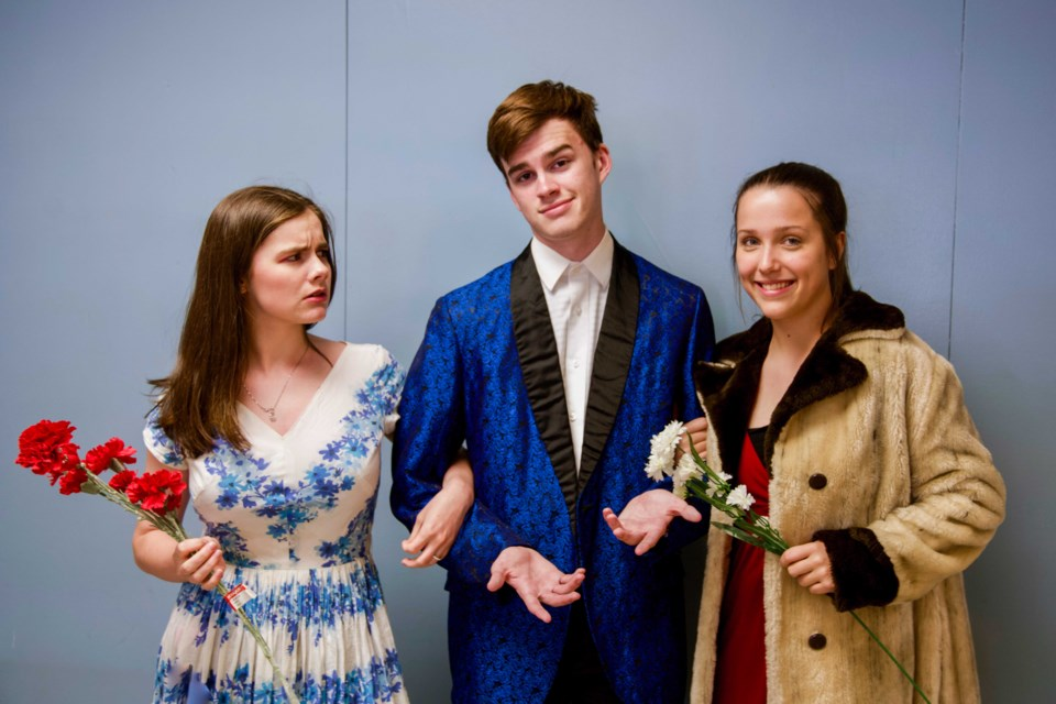 Arrogant businessman Nero Sharpe, played by Charlie O'Connor, centre, dies suddenly after eating a meal at Luigi's Italian restaurant in Who Poisoned His Meatball?, a dinner theatre production by New Westminster Secondary School drama students. Emily Kleamyck, left, portrays Nero's wife Flora Sharpe and Alia Homenuke plays his mistress Arlene D'Amore.
