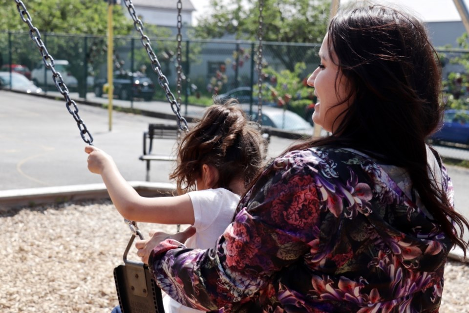 Ronda Merrill-Parkin plays with her daughter in a Vancouver schoolyard. Brielle Morgan/The Discourse