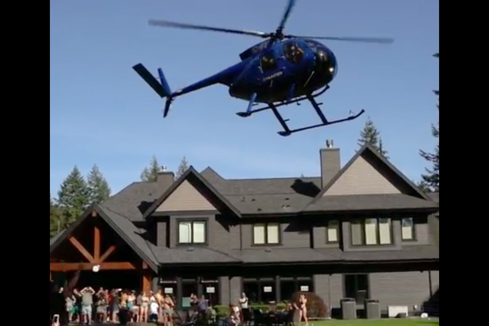 A helicopter lands at the party in Anmore