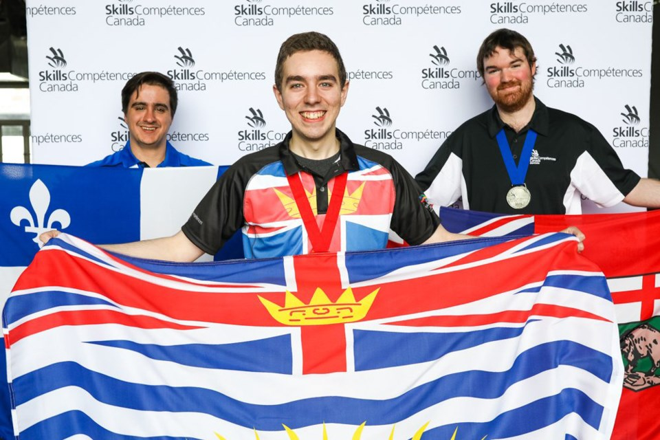 BCIT computer student Gio Porta, centre, poses with other medal winners in post-secondary IT Network Systems Administration at the Skills Canada National Competition in Halifax last month. Porta won gold for the second year in a row.