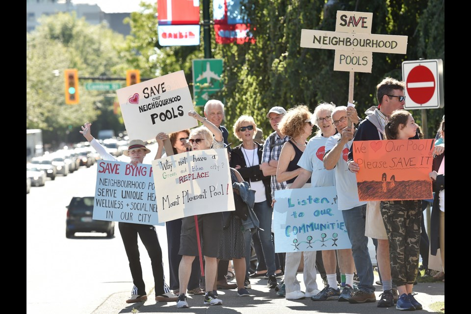 A group of residents rallied outside Vancouver City Hall at 12th and Cambie Monday evening. They wanted to make sure members of the VanSplash advisory committee heard their message — keep the city's small community pools open. Photo Dan Toulgoet