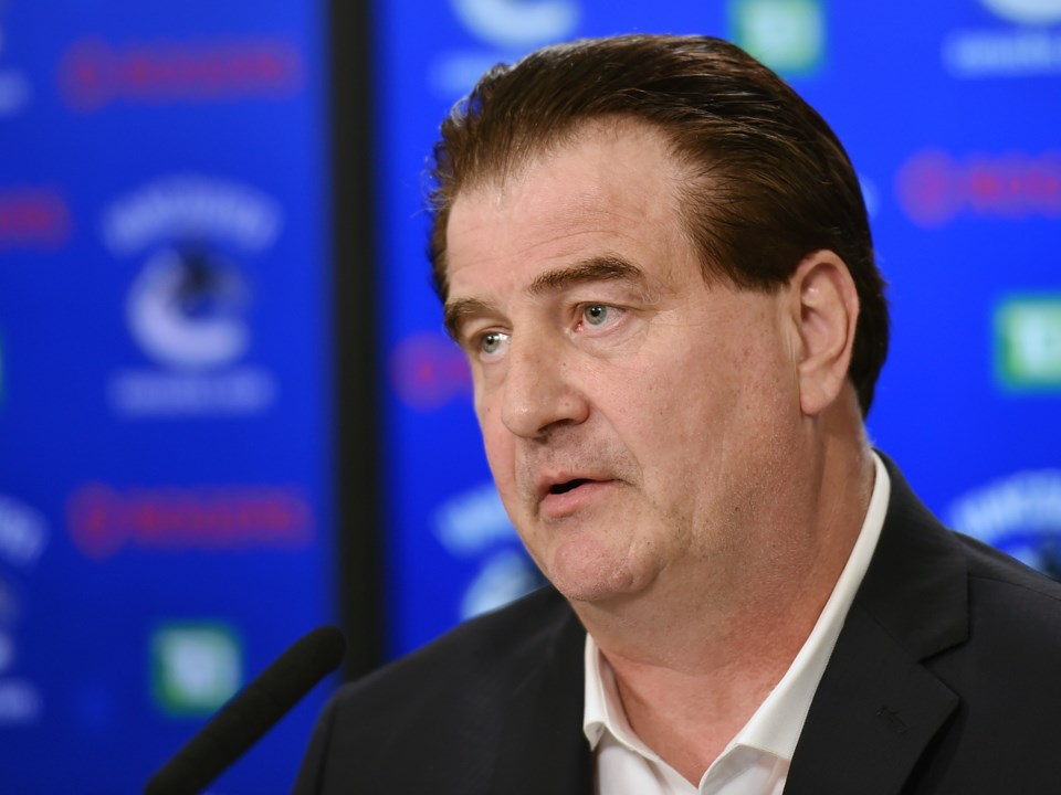 Jim Benning speaks to the media.