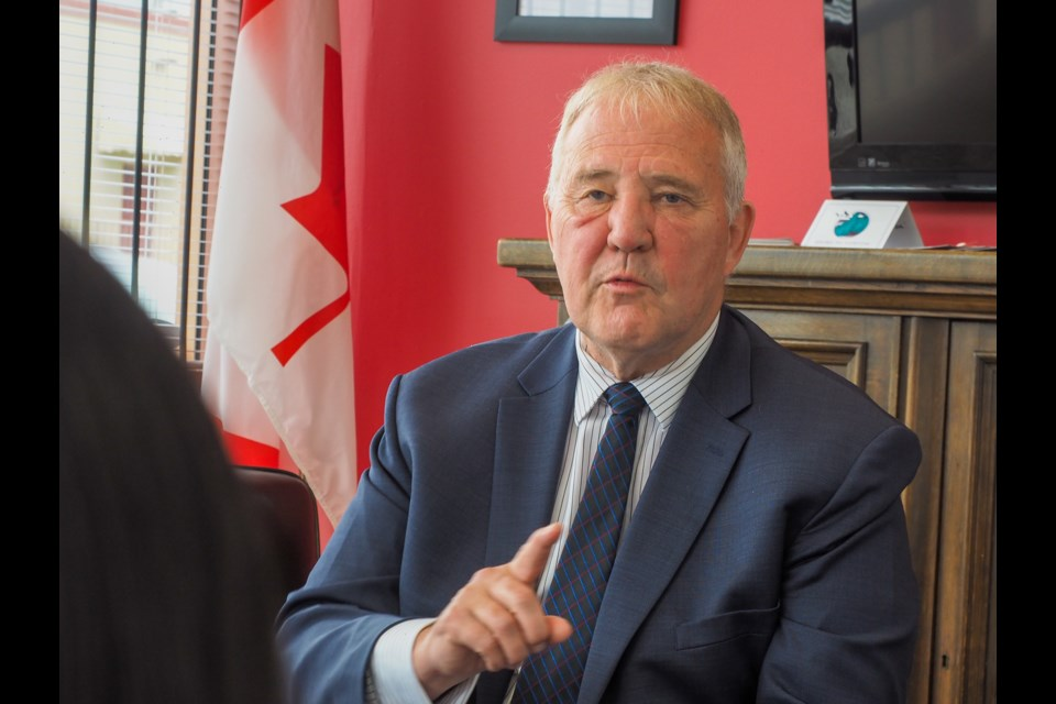 Bill Blair, Minister of Border Security and Organized Crime, talks to a Tri-Cities Chinese community group at MP Ron Mckinnon's constituency office