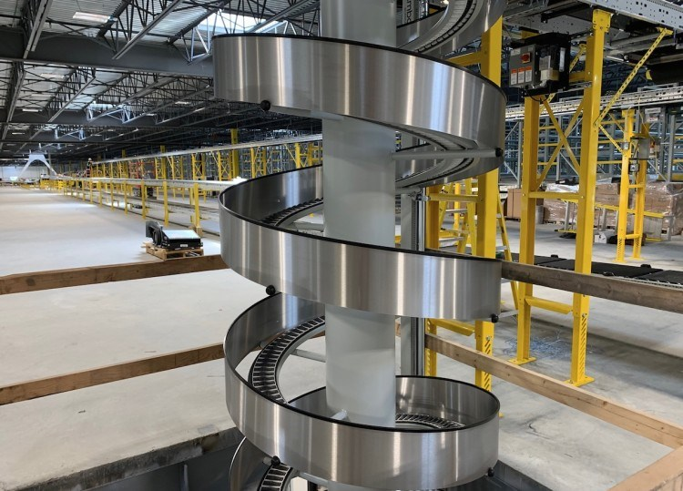 One spiral conveyor at Amazon's Tsawwassen facility carries goods from an upper floor to a lower one