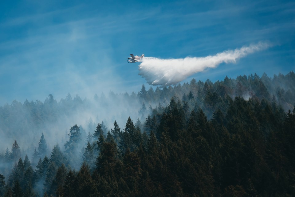 Aerial crews fight Pender Harbour fire on Tuesday.