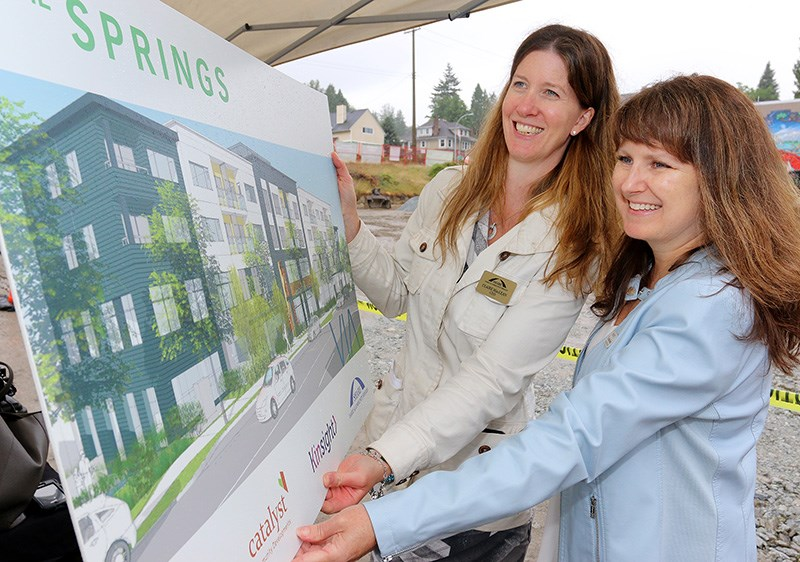 Christine Scott, CEO of Kinsight, and Claire MacLean, CEO of Share Family and Community Services, check out the plans for The Springs, a joint project by the two agencies plus St. Andrews-Ioco united Church and Catalyst Community Developments Society to build 55 units of affordable housing on the church property. It will also include the new Tri-Cities Children's Centre, which will provide services and programming for families of children with developmental delays and disabilities.