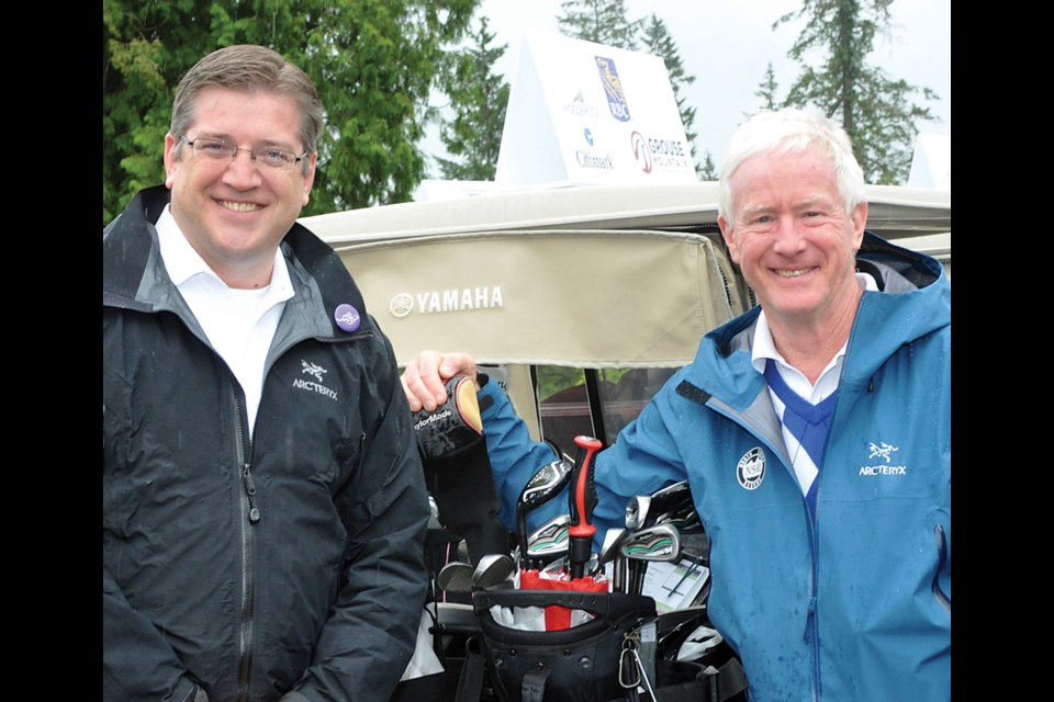 Current District of North Vancouver Mayor Mike Little and former mayor Richard Walton.