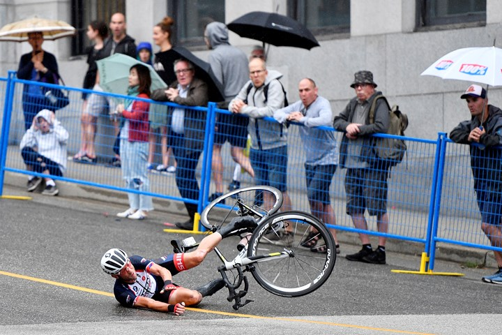 Fans react as a Kaler Marshall of Walla Walla, Wash., crashes during one of Tuesday night's wet Grand Prix races in downtown New Westminster. This race is considered by some as the toughest of the Superweek races due to our city's hills - both for the climb up and the speeds riders reach while coming down. JENNIFER GAUTHIER PHOTO