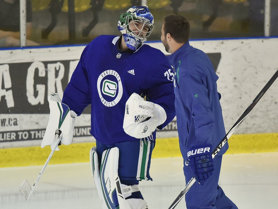 Michael DiPietro shares a laugh with former-Canuck Chris Higgins at Canucks 2019 Development Camp.
