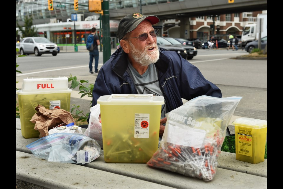 Charles Bafford, who lives in a modular housing building at Main and Terminal, spends his days picking up discarded needles in Vancouver. Photo Dan Toulgoet