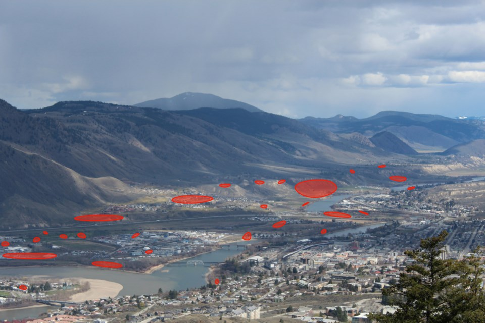 In this aerial view of Kamloops, archeological sites are marked in red.
