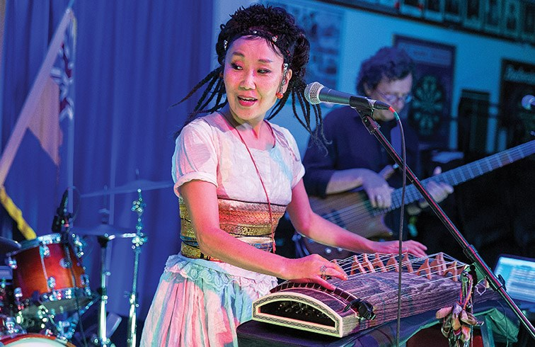 Lead singer Namgar Lhasaranova plays a yatga while performing with her band Namgar on Thursday night at the Prince George Legion. Namgar played a fusion of traditional Mongolian and Buryat music with modern pop, folk, jazz, and rock. Citizen Photo by James Doyle