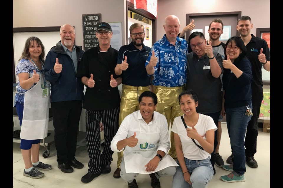 The folks at the Union Gospel Mission were all smiles when New West Mayor Jonathan Cote and Burnaby Mayor Mike Hurley served breakfast while wearing gold lamé pants - the result of a bet between the two communities as part of this year's Walk 30 Burnaby/New West 2019 community walking challenge.
