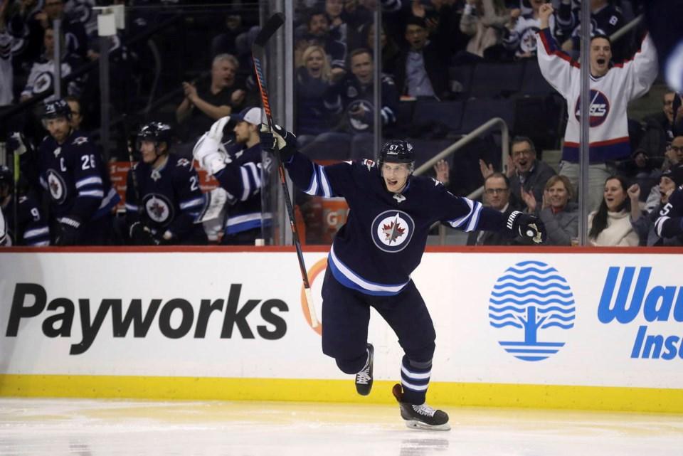 Tyler Myers celebrates a goal with the Winnipeg Jets.