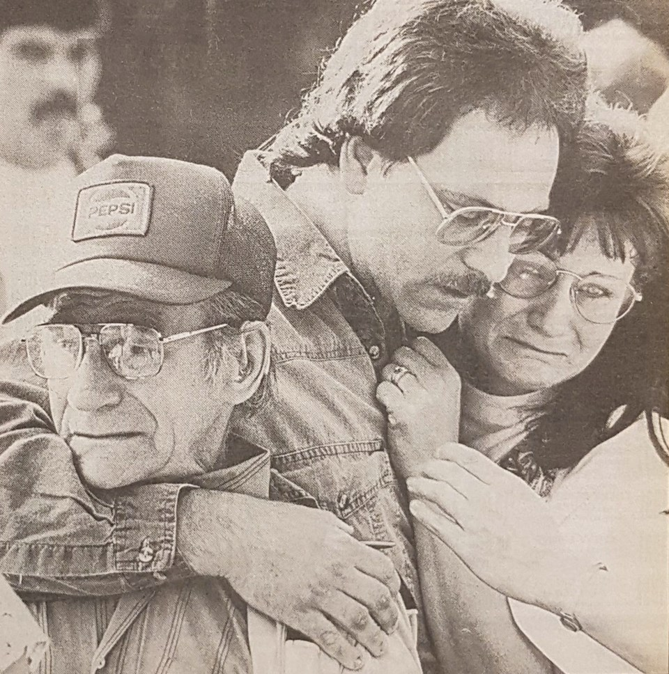 David Niven, brother of the slain man, is comforted by other relatives outside the Port Coquitlam co