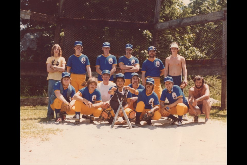 Bowen Island Men's Baseball Team 1976. From left to right, front row: Chris McCulloch, Rick Morgan, ?, George Helenius, Kim Larsen, ?, John Sbragia, ?. From left to right, back row: ?, Don Toffaletto, ?, Nelson Riley, Eddie Weismiller, ? . (Please inform the Undercurrent if you know the missing names of any team members).