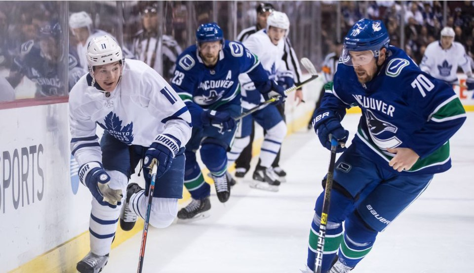 Tanner Pearson skates for the puck for the Vancouver Canucks