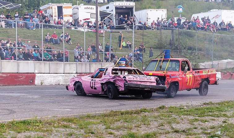 The crowd looks on as Kyle Wozney spins out the #01 car of Edgar Laurin on Saturday evening at PGARA Speedway Park as the pair compete in a bucket race during the Labour Day Classic Hit to Pass event. Citizen Photo by James Doyle