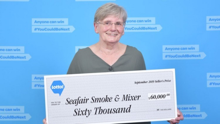 Verna Holmes holds a cheque awarded to her Seafair Smoke & Mixer at Seafair Shopping Centre on Sept.