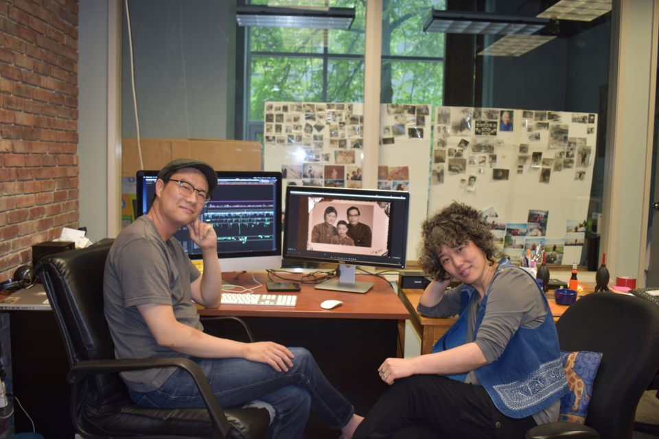 Ying Wang(right) and Lawrence Le Lam(left) were putting the finishing touches to their documentary in their studio before the film's world premiere.