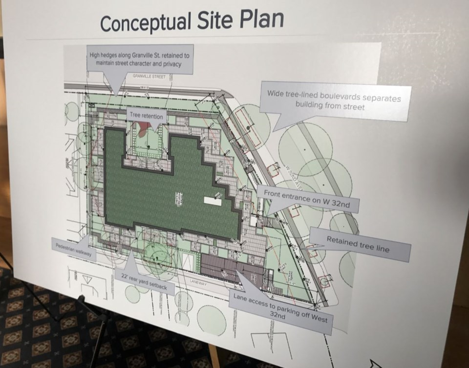A display board at the pre-application open house shows the conceptual site plan.