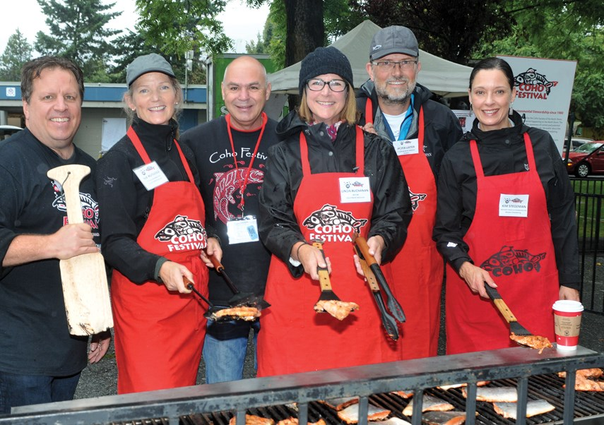Salmon barbecue chef volunteers Gary Mussatto, British Pacific Properties' Sue Rutledge, Park Royal's Rick Amantea, North Vancouver City Mayor Linda Buchanan, Seaspan's Peter Lister and Western Stevedoring's Kim Steegman.