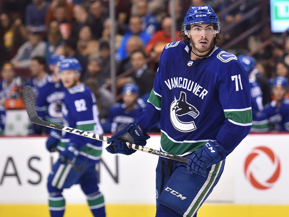 Zack MacEwen skates for the Canucks in the 2018 preseason.