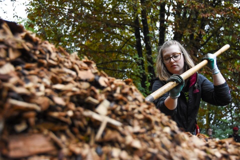 Meaghan Ryley, who works with BC Housing, volunteered her Saturday to shovel mulch into a wheelbarrow at Finnie's Garden, all part of an effort to revitalize garden that was first used for therapy at Rivrerview Hospital in the 1950s.