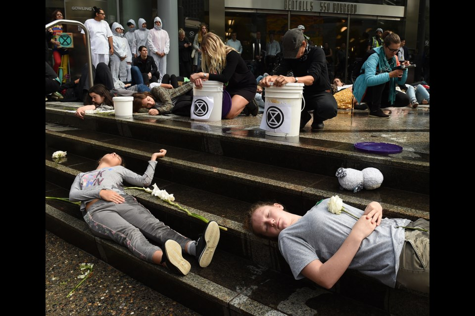 Sustainabiliteens Vancouver held a die-in for action against climate change Friday downtown at different locations, including Teck Resources Ltd., marched to the Vancouver Art Gallery to end their day of protest. Photo Dan Toulgoet