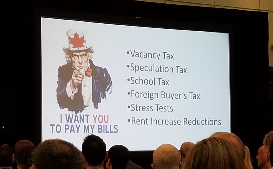 Jurock's presentation addressed what he says are the negative impacts new government programs are ha