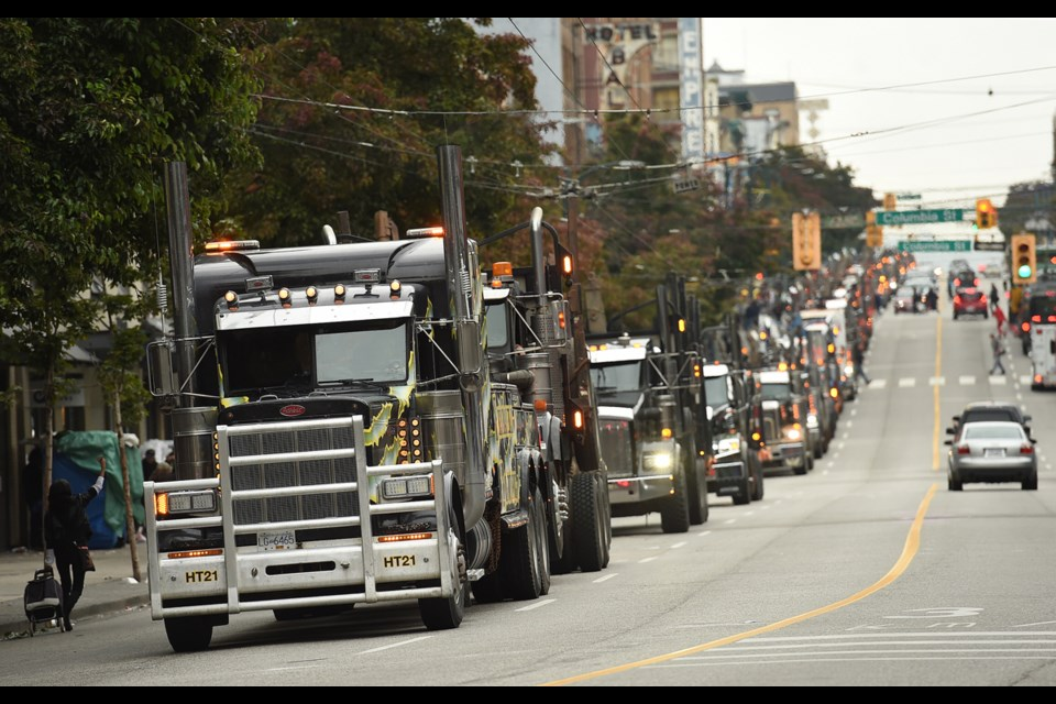 Hundreds of logging trucks lined up along Hastings Street as they made their way into Vancouver to protest the state of the B.C.'s forestry industry. Photo Dan Toulgoet