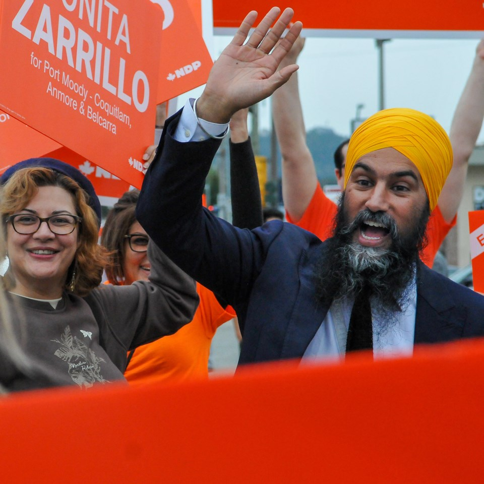 NDP leader Jagmeet Singh greets supports along St Johns Street in Port Moody Wednesday