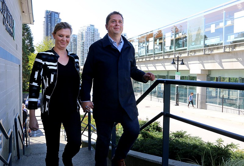 MARIO BARTEL/THE TRI-CITY NEWS Conservative party leader Andrew Scheer arrives at Coquitlam's Evergreen Cultural Centre Friday, with his wife, Jill, to make an announcement about transportation infrastructure.