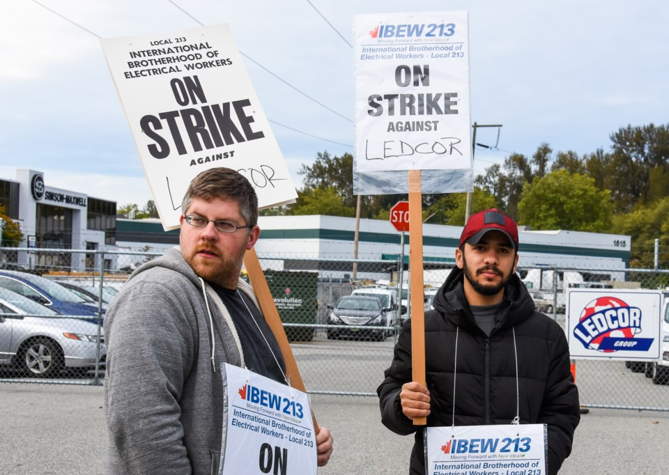 Workers strike outside Port Coquitlam's Ledcor facility