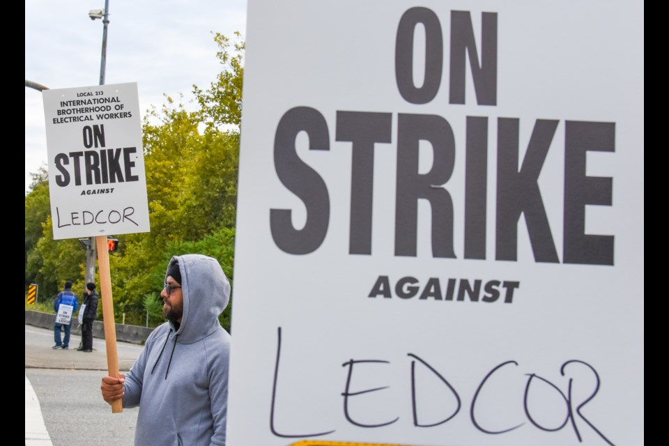 The telecommunication technicians strike from IBEW 213 strike at the intersection of Broadway St. and Mary Hill Bypass in Port Coquitlam