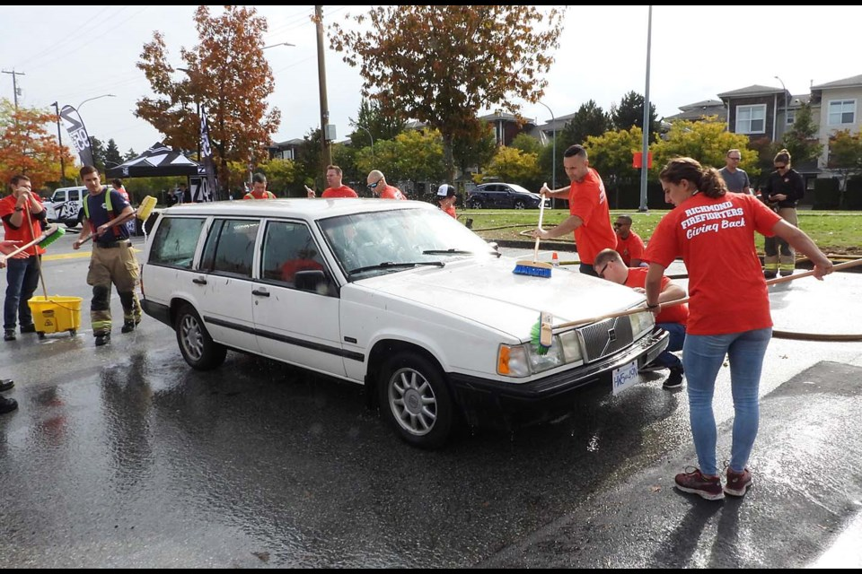 Richmond firefighters hosted a charity car wash Sunday. Photos by Boaz Joseph/Special to the News