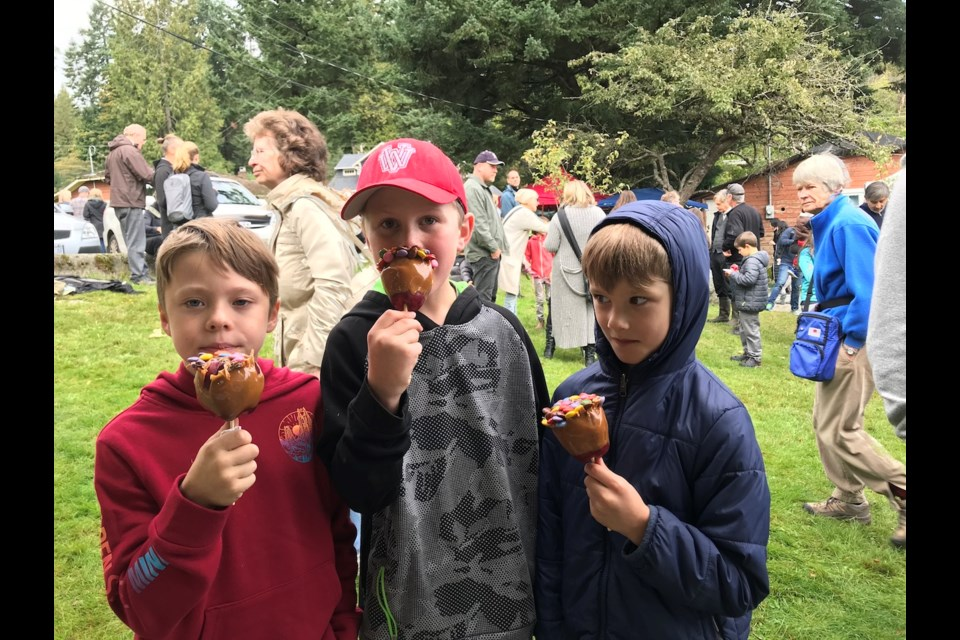 Denis Cormier (in the red hat) and a couple of friends were among the caramel apple aficionados.