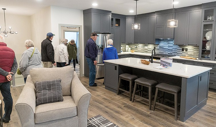 Guests tour a Lithium One Homes house at 4034 Brink Drive on Sunday during the Canadian Home Builders' Association of Northern BC's Parade of Homes. Citizen Photo by James Doyle
