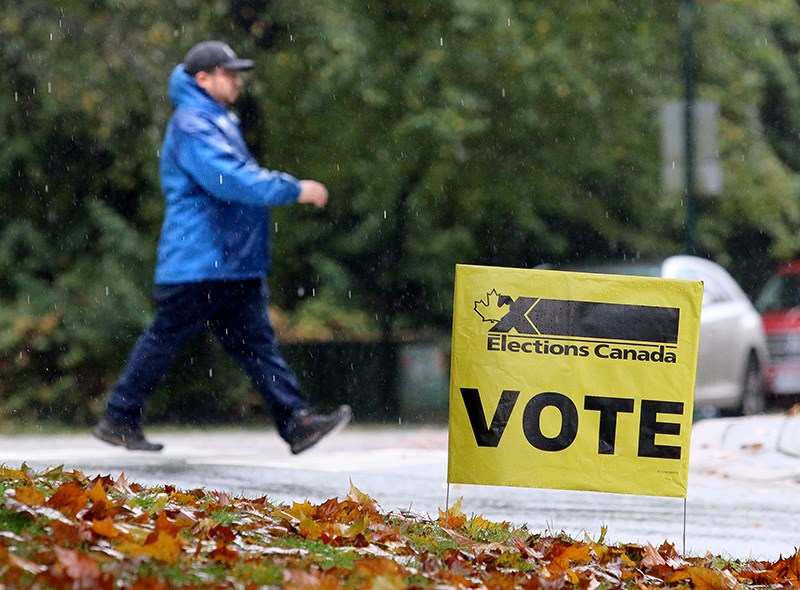 Voters heading to the polls in Monday's federal election brave heavy rain and cold temperatures.