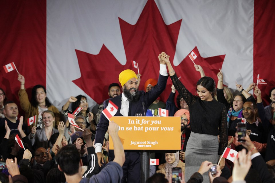 Jagmeet Singh and his wife, Gurkiran Kaur, acknowledge the crowd as Singh appeared to give his speech to Canadians.