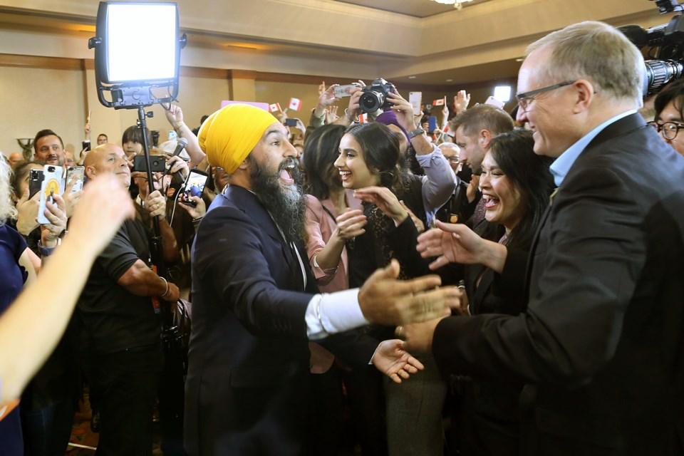 Jagmeet Singh greets successful NDP candidates Jenny Kwan and Peter Julian at the NDP celebration election night.