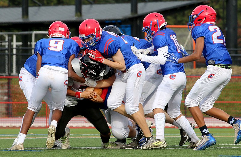An Abbotsford Panthers ball carrier is tackled by a pack of Centennial Centaurs defenders in their BC Secondary Schools Football Association junior varsity game, last Wednesday at Percy Perry Stadium in Coquitlam. Centennial won, 42-8.