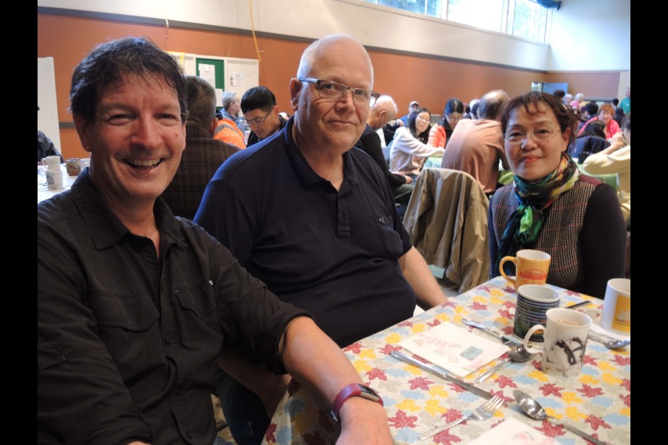Three members of the Richmond community, including Steven (left and Wesley (centre), who came along for the St. Alban's community meal and now volunteer at the free Tuesday dinner. Alan Campbell photos