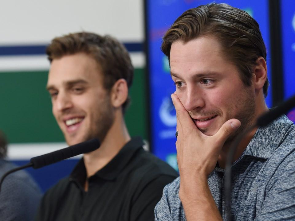 J.T. Miller and Brandon Sutter laugh at the Canucks 2019 media day.