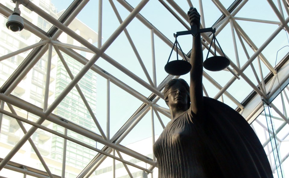 Scales of justice at BC Supreme Court