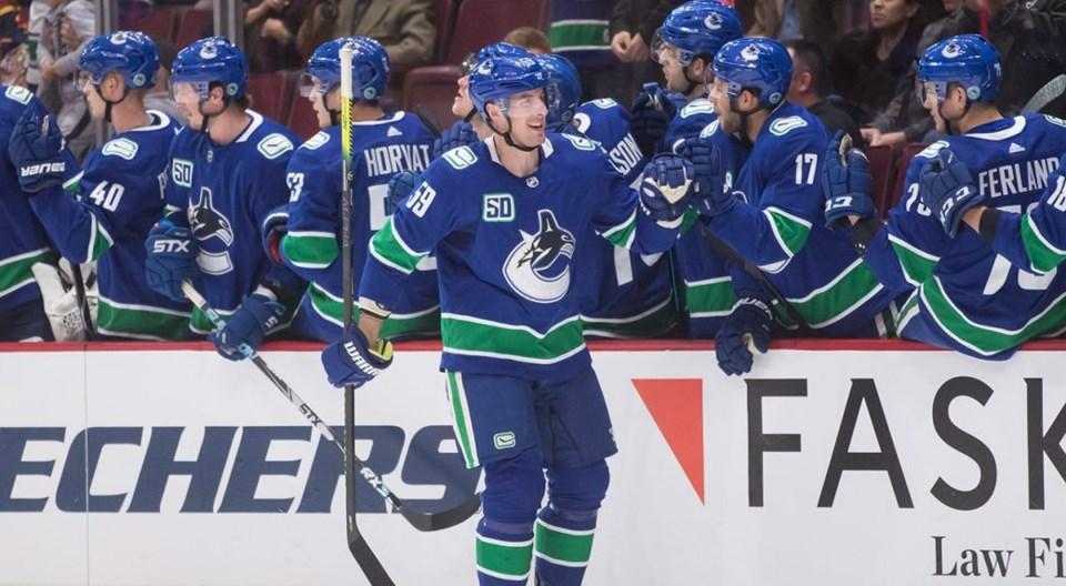 Tim Schaller celebrates a goal for the Vancouver Canucks