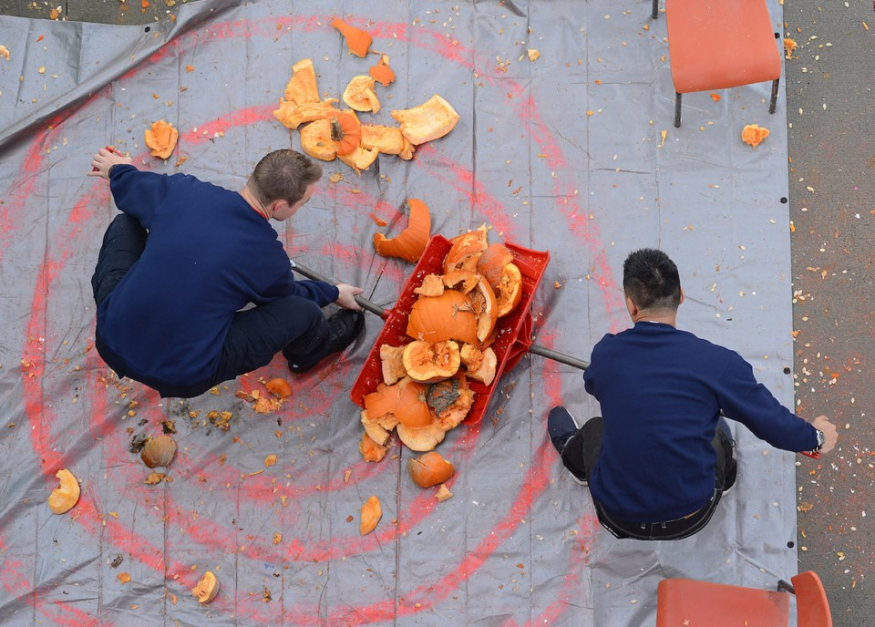 Photos: Smashing pumpkins for charity with Richmond fire crews_7