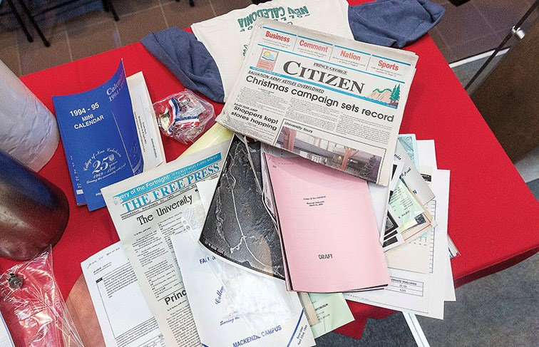 Items from the 50th anniversary time capsule sit on a table at CNC on Wednesday afternoon. The capsule was sealed in 1994 and opened during a ceremony to mark the 50th anniversary of the college. Citizen Photo